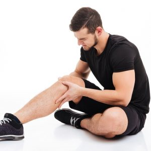Man using his hands to recover from knee injury